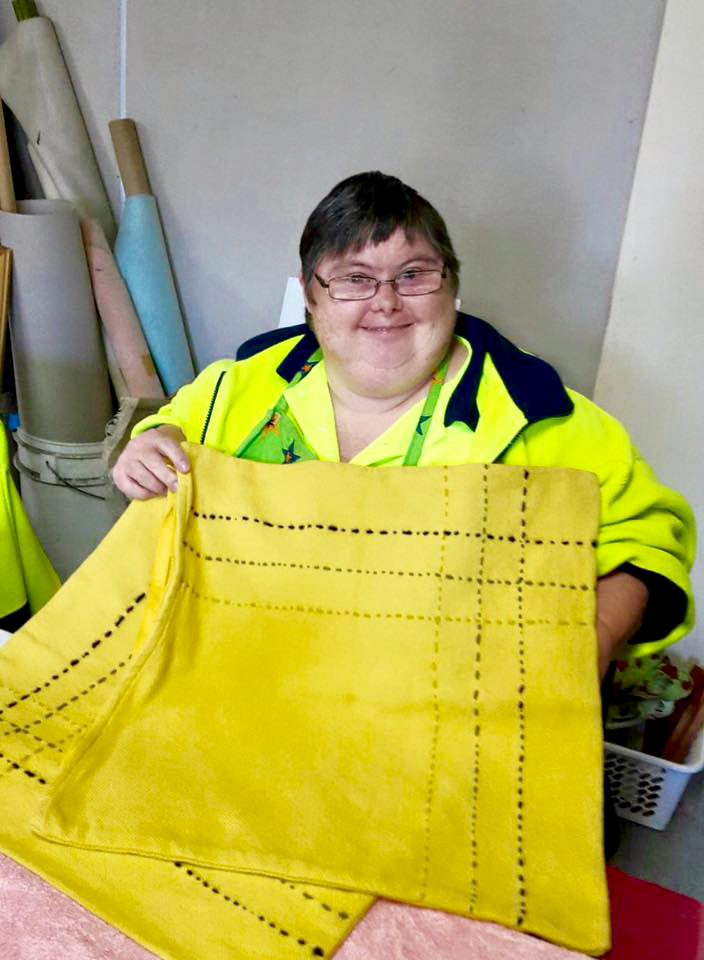 Learn to work with sewing and textiles, cutting and constructing materials, supported employment Central Coast.
