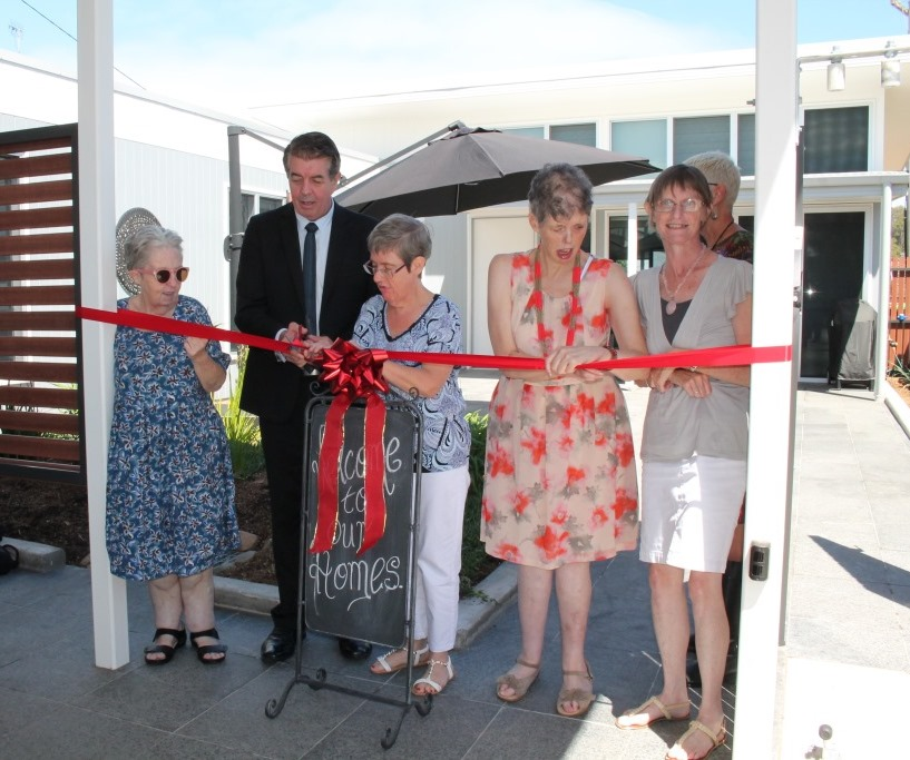 The Hon. Ray Williams cuts the ribbon with Fairhaven residents Julianne, Lindy-Sue, Jo-Ann and Ruth.